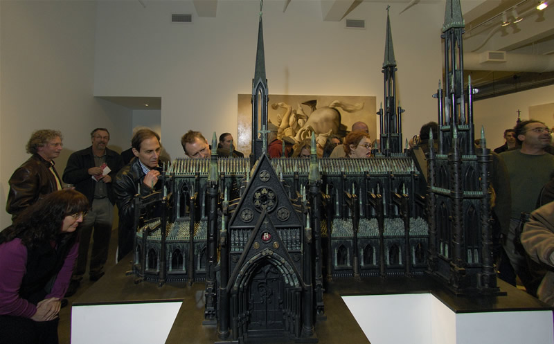 Al Farrow Monumental Cathedral made of guns, bullets, ak47